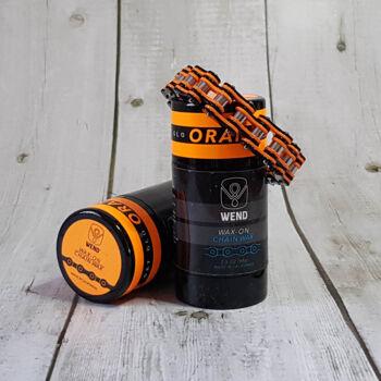 Csomag tartalma: 1 db Wend Wax-On Láncwax  1 db Kerékpárlánc karkötő KTM narancssárga